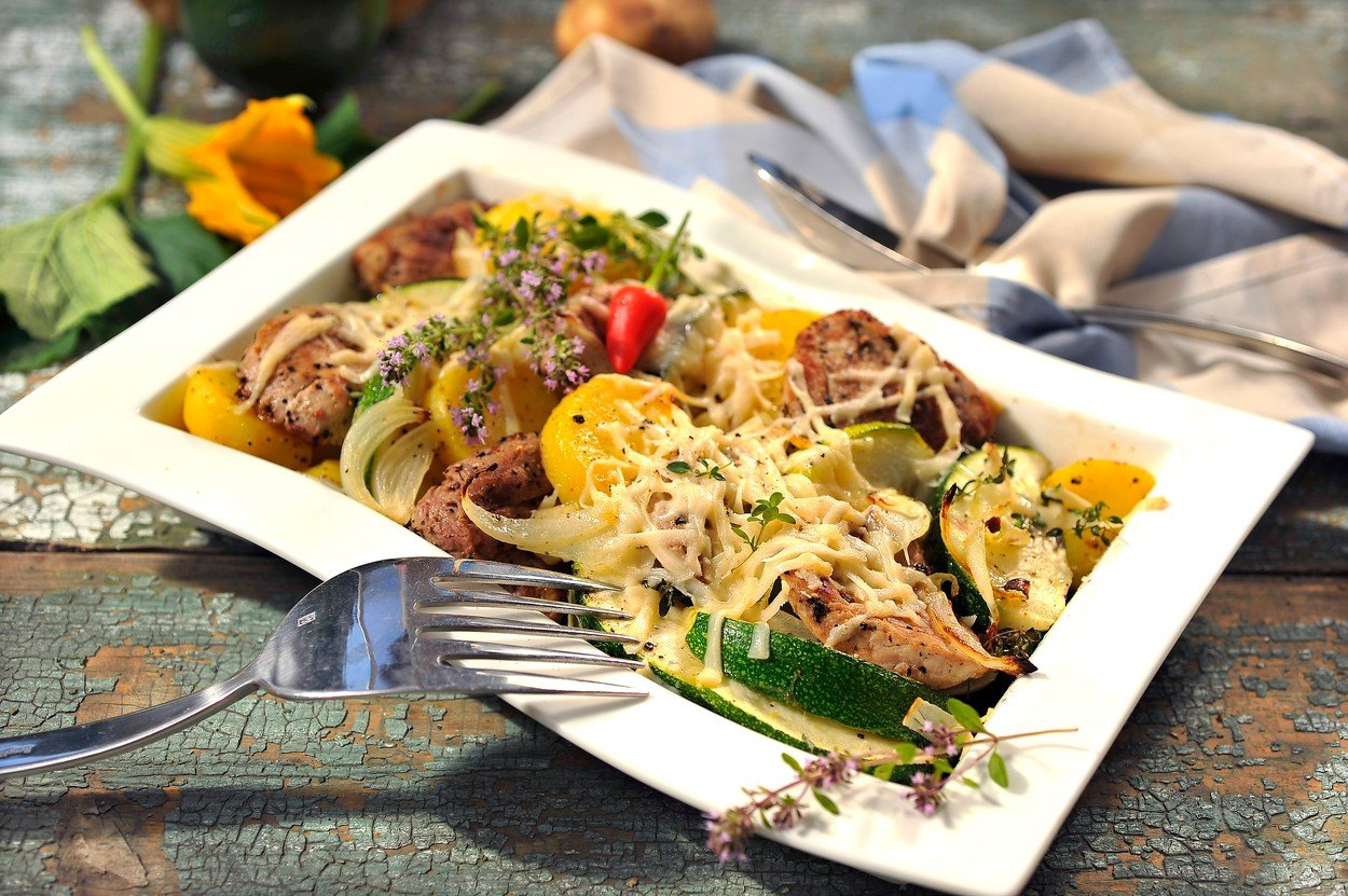 Baked potatoes with zucchini and pork