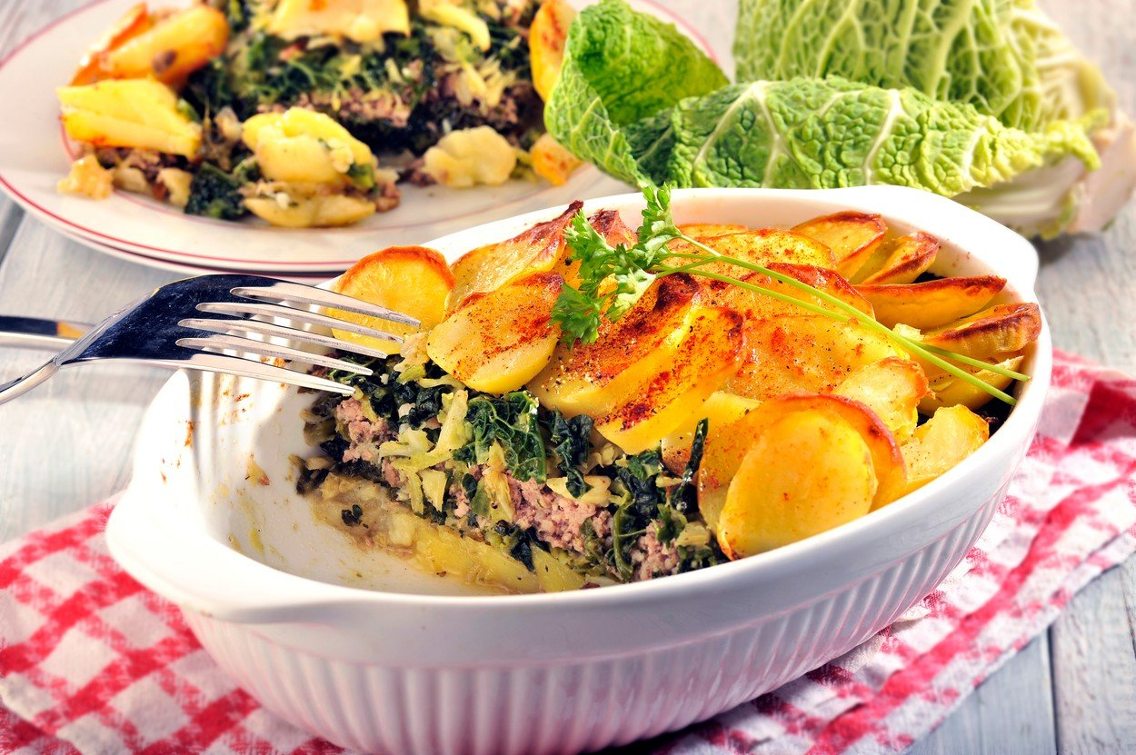 Baked Potatoes with Sausage Meat and Cabbage