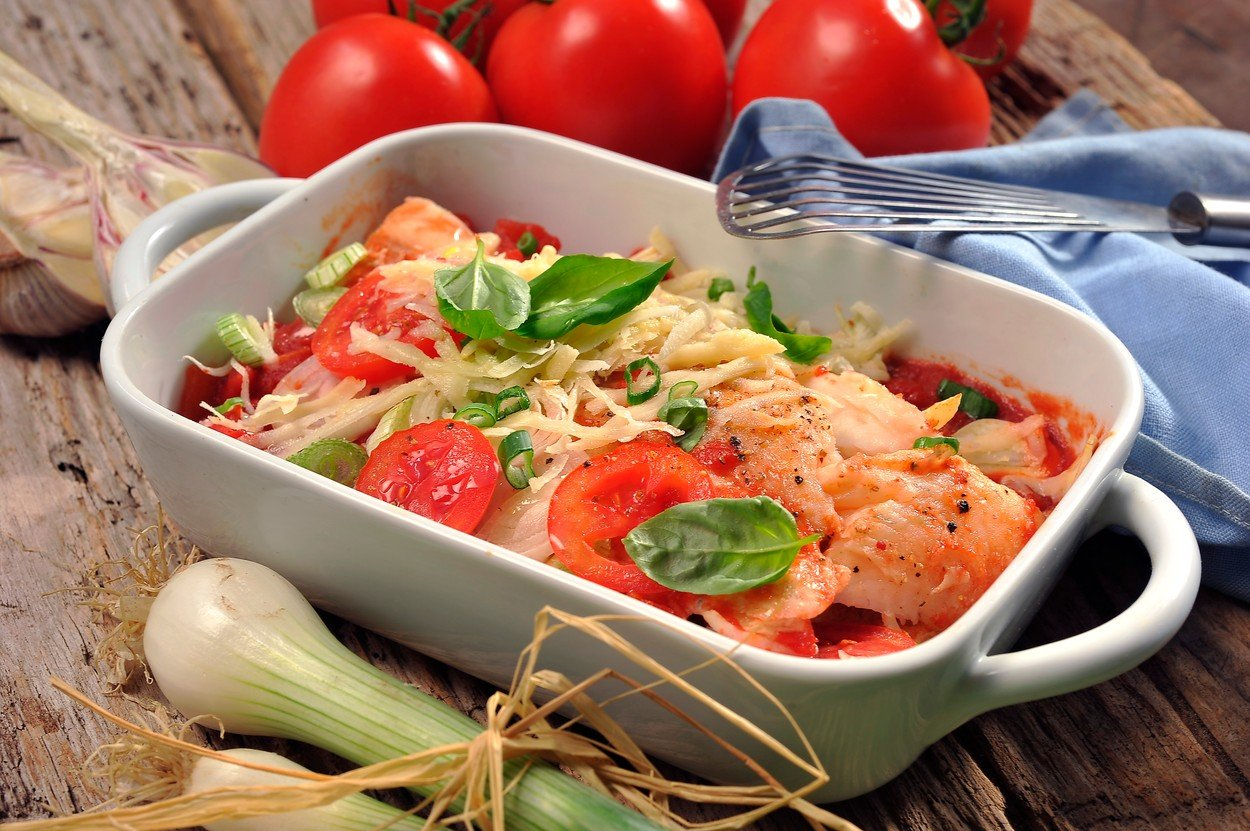 Fish baked with tomatoes