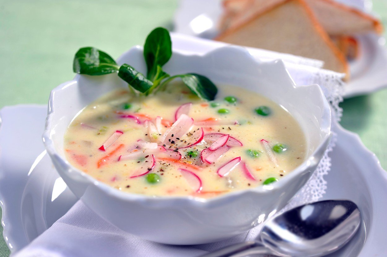 Cheese soup with spring vegetables